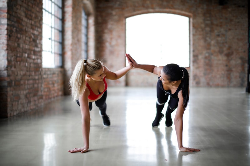 fitness clients give high five